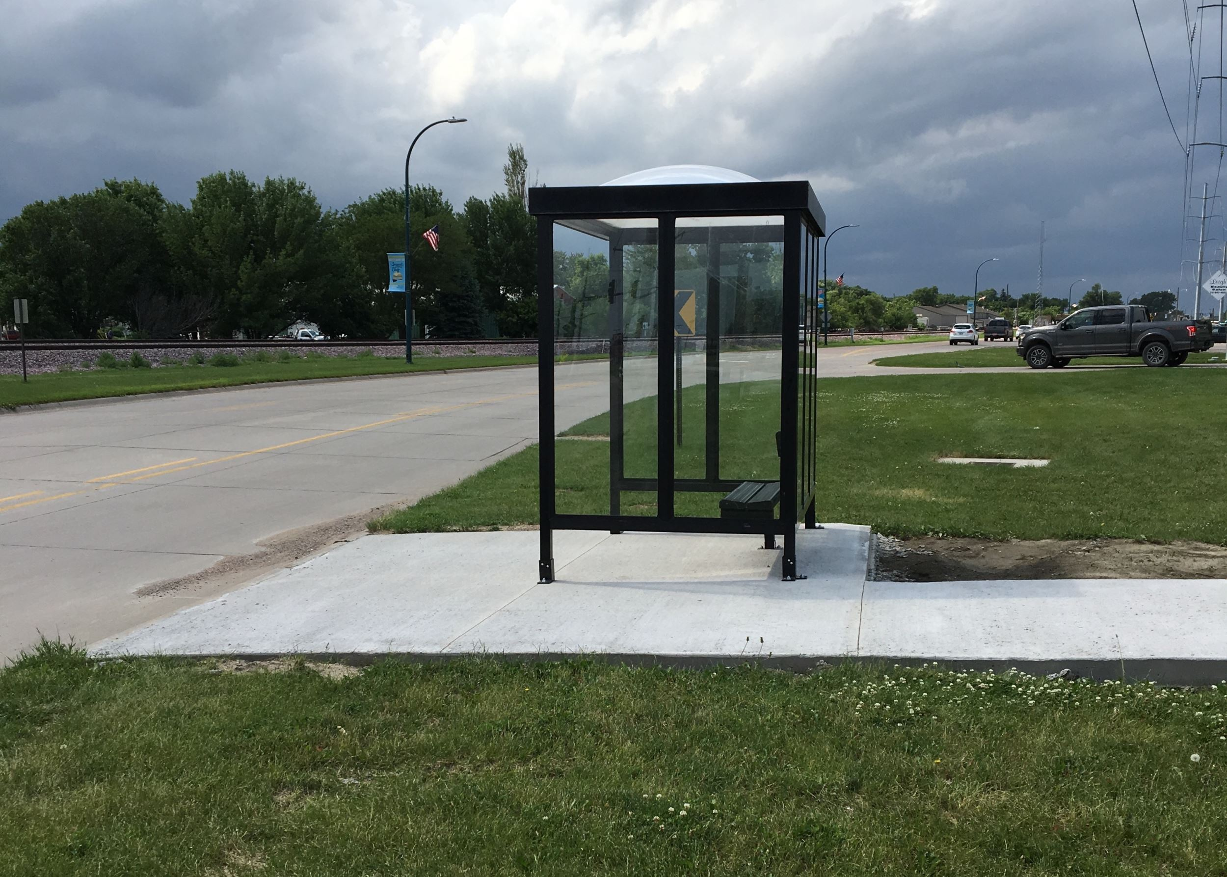 Bus stop and sidewalk in Sergeant Bluff